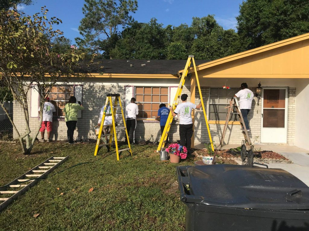 Firefighters paint the blind veterans house