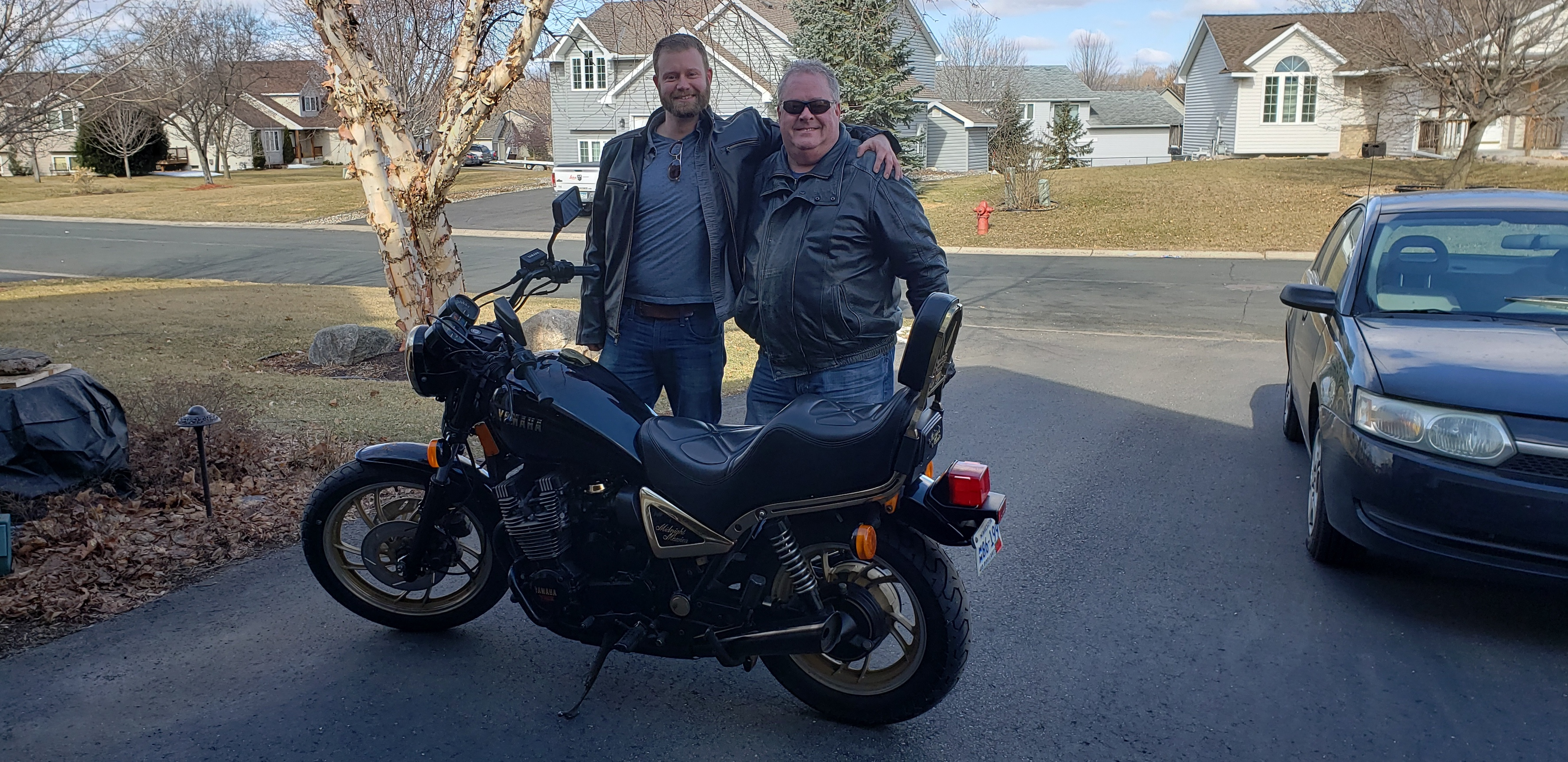 Jimmy Tarpey and his dad Jim Tarpey next to the motorcycle