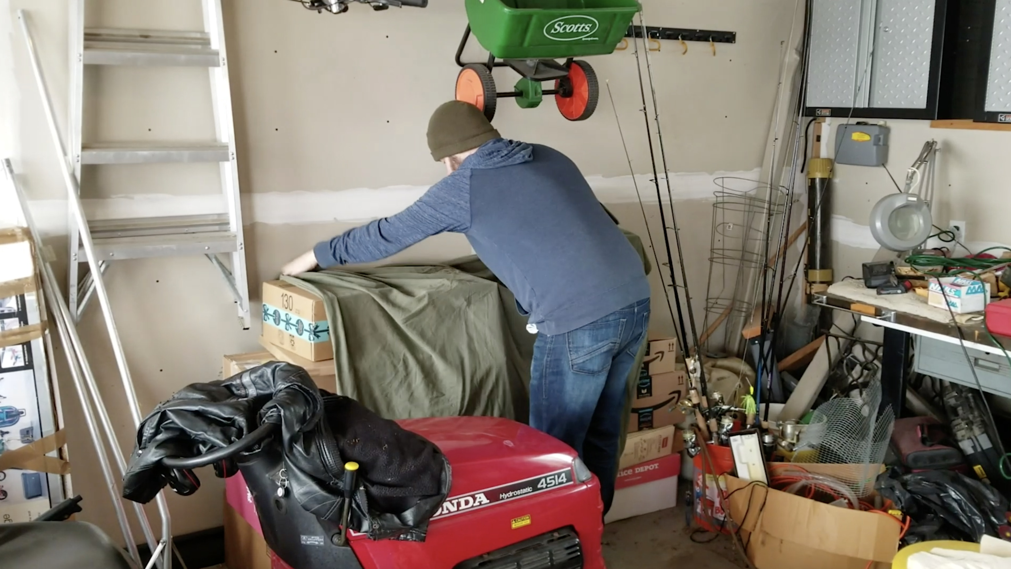 Jimmy Tarpey creating a fake bike out of boxes
