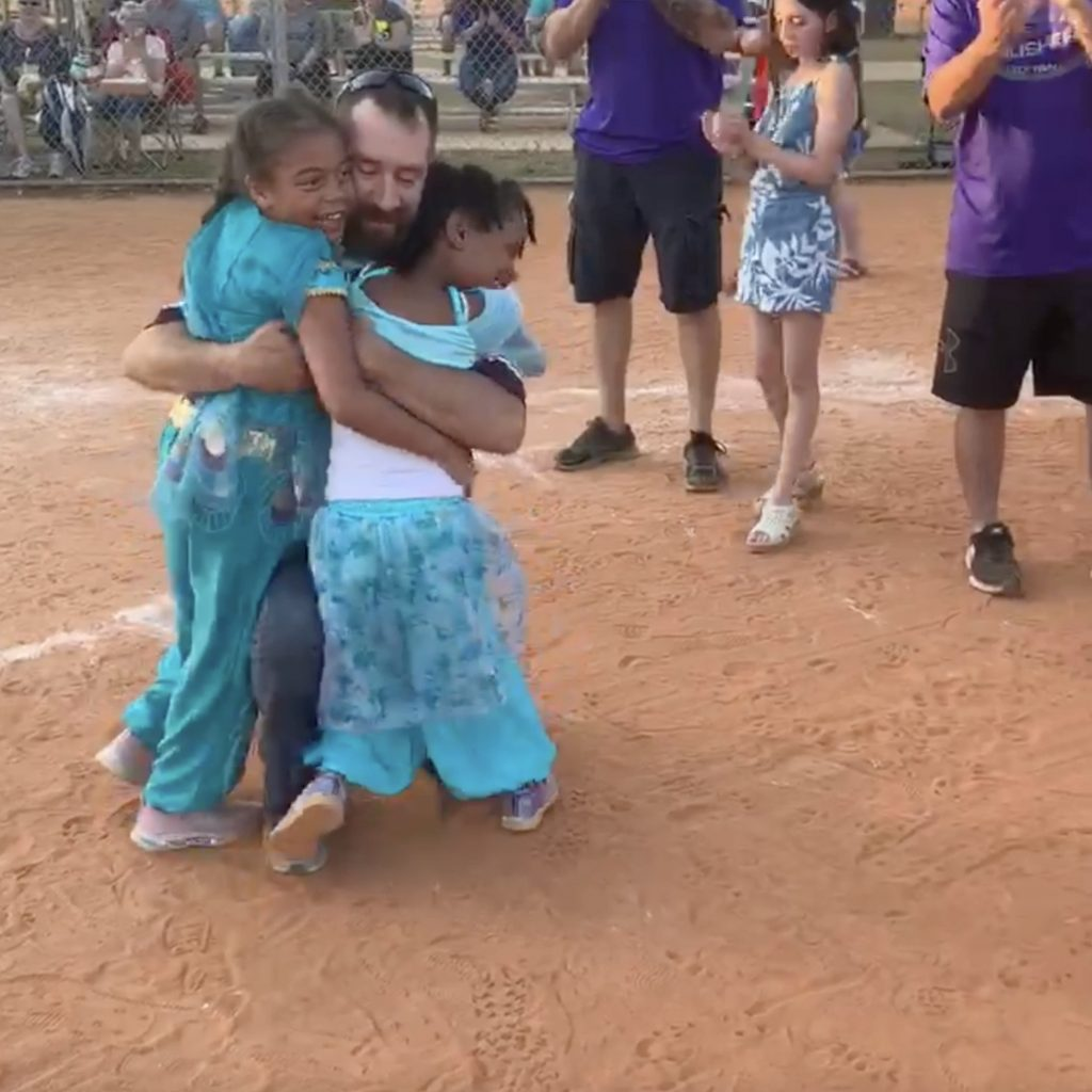 Taya and Liberty Bunger embrace dad Jake