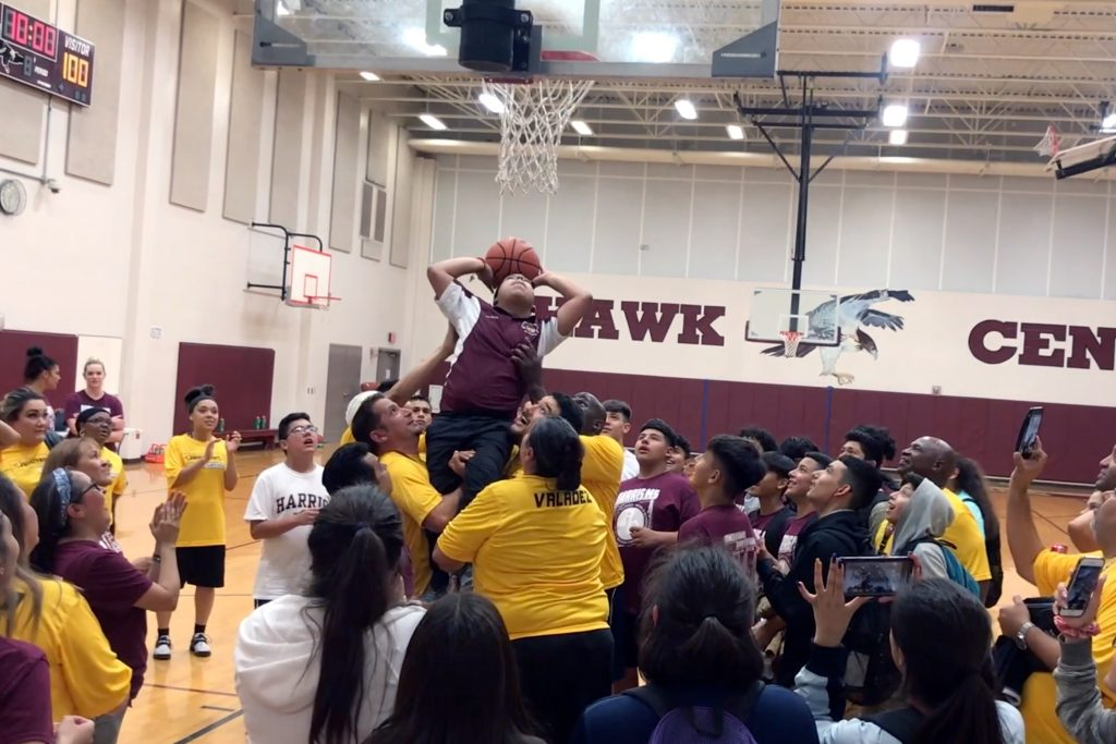 Tristan Garcia lifted up out of wheelchair to score first ever basket