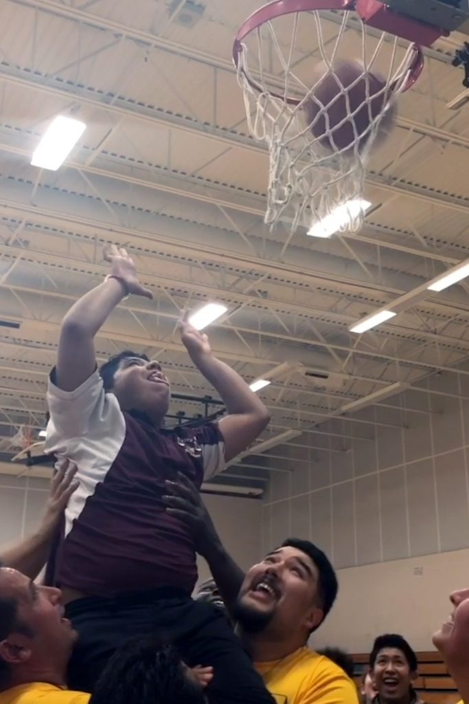 Tristan Garcia lifted up out of wheelchair to score first ever basket.
