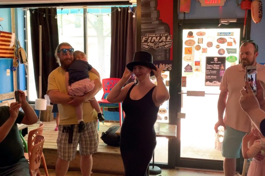 Theresa Coleson wearing a hat hiding the color of her hair and the gender of her baby.