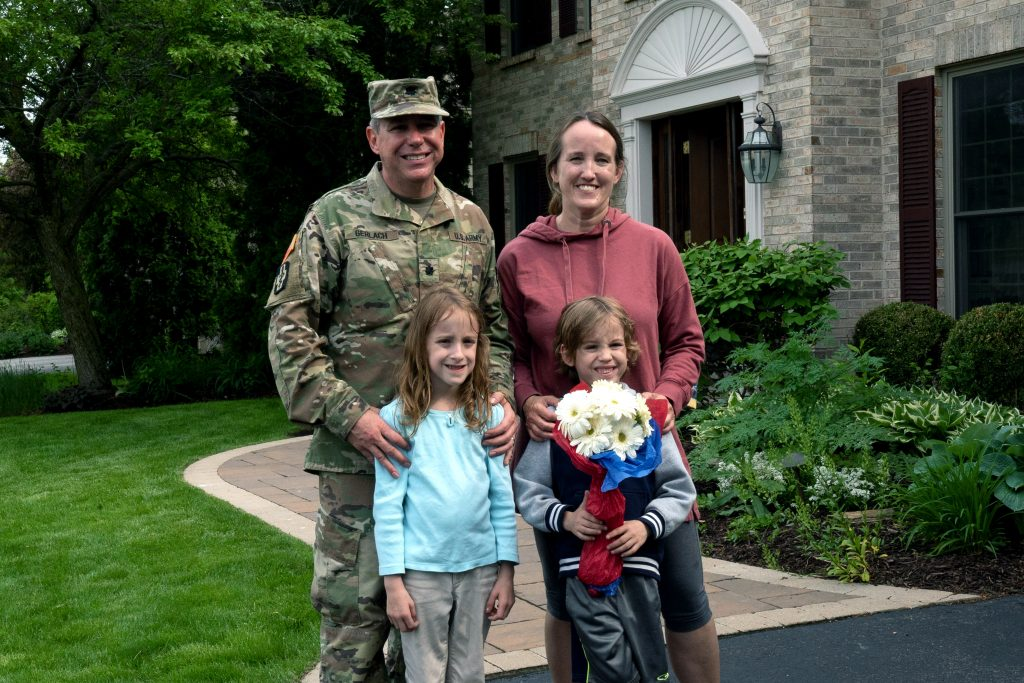Rob with his family after he surprised his wife from the delivery box