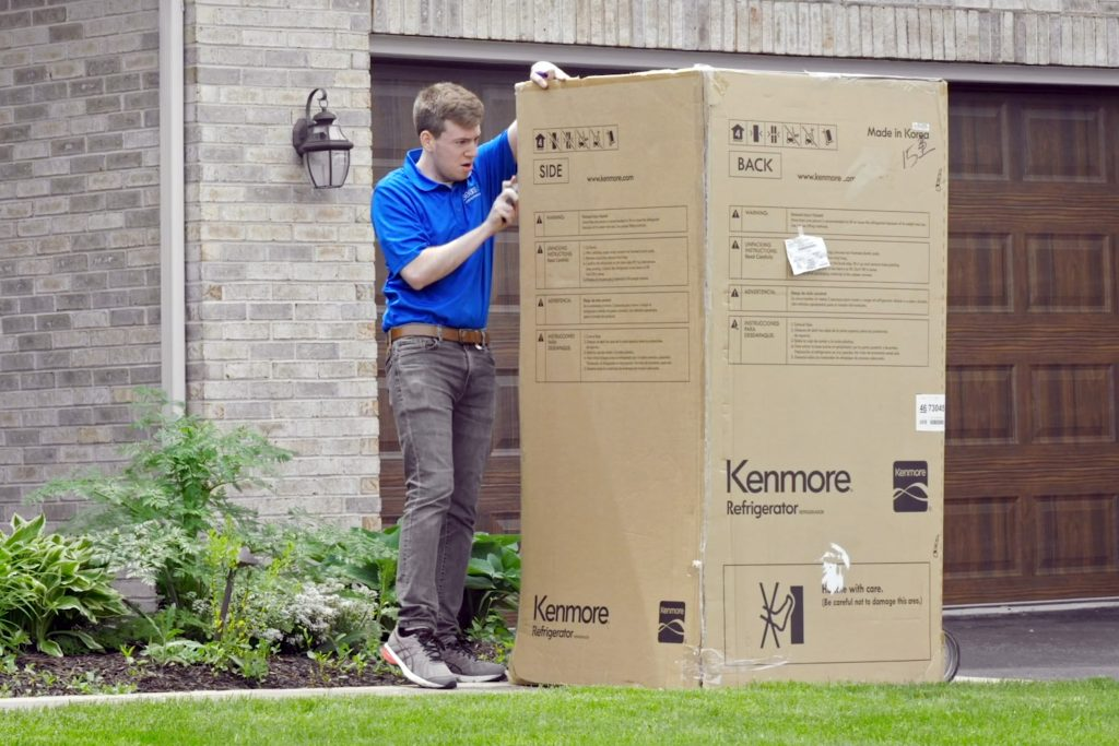 Delivery man cutting Rob from delivery box