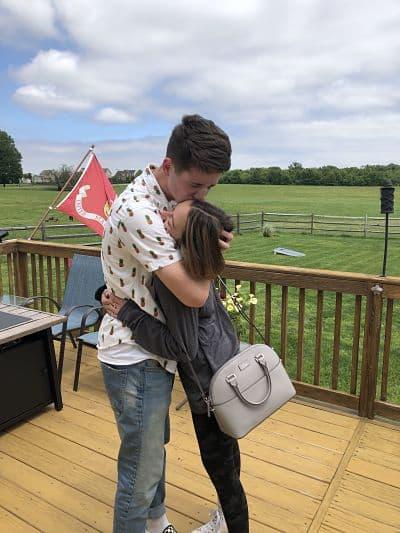 Marine surprises girlfriend at prom dress fitting