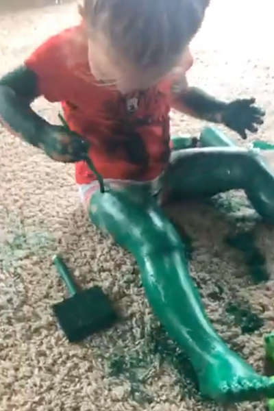 Girl paints herself green like incredible hulk