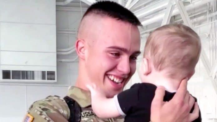 Soldier meets newborn son