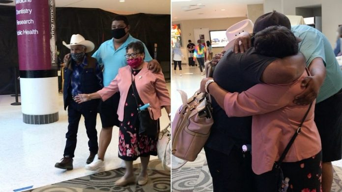 brothers reunited with parents