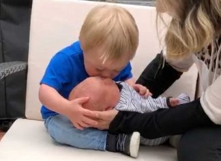 Baby with down syndrome meets brother