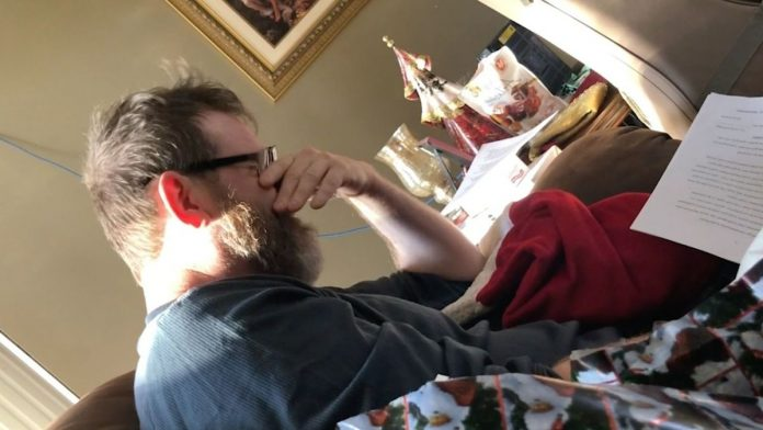 A stepdad cries as he is surprised with adoption papers