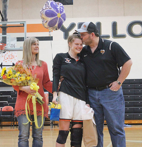 Dad supporting his daughter
