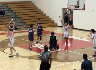 wheelchair-bound teen sets up basketball play
