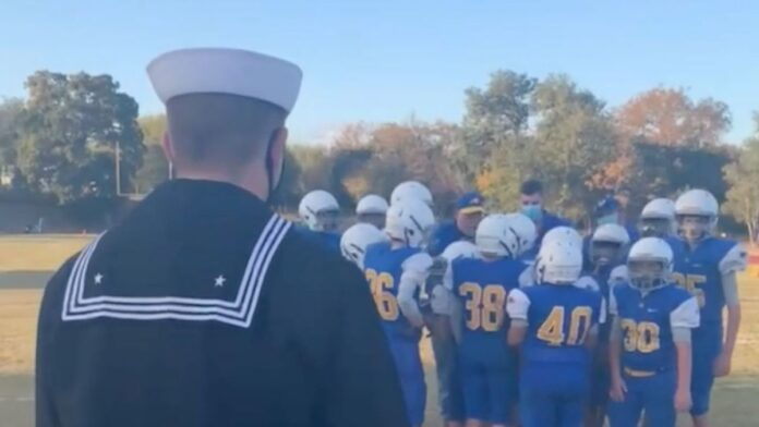 Navy brother surprises sibling during football huddle